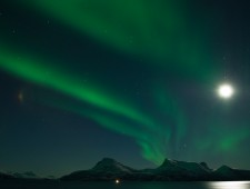 Northern lights(aurora borealis) and moonlight over Tysfjord.